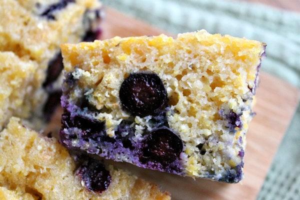 close up shot of a piece of blueberry cornbread