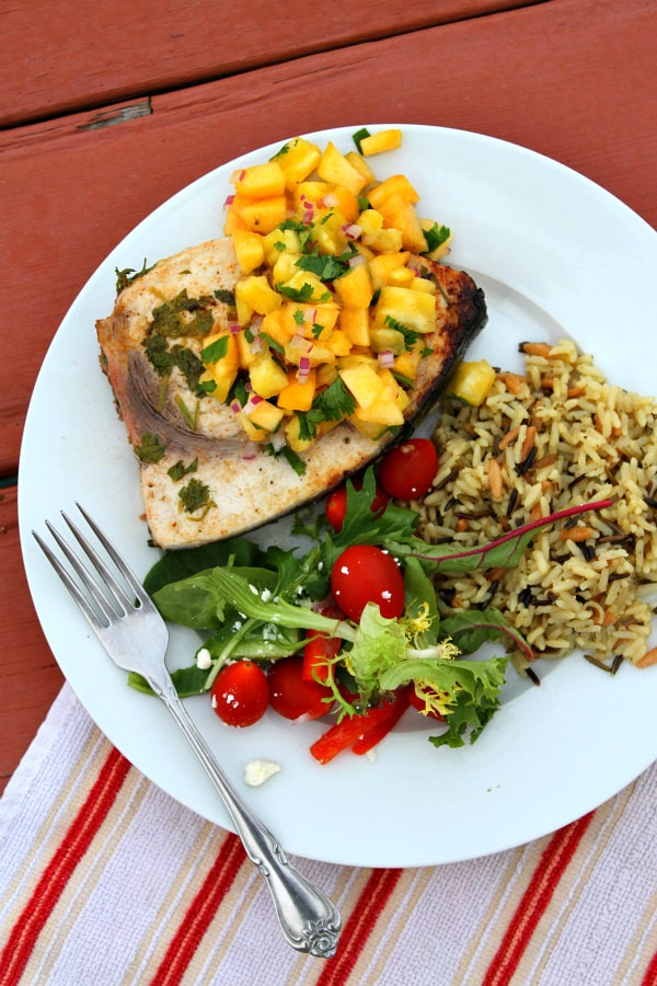 Grilled Swordfish with Pineapple Peach Salsa served with salad and rice