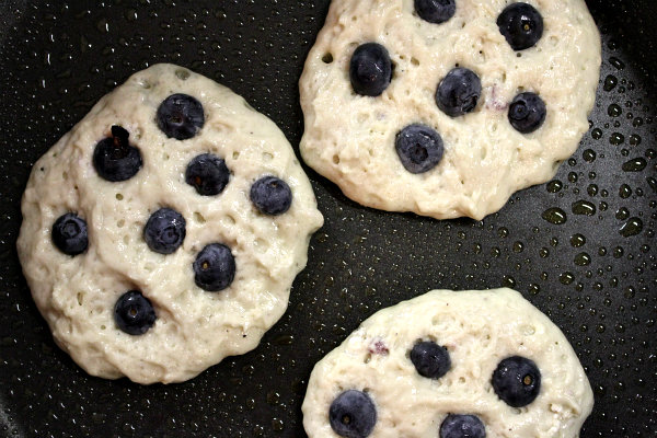 Blueberry Greek Yogurt Pancakes on the griddle