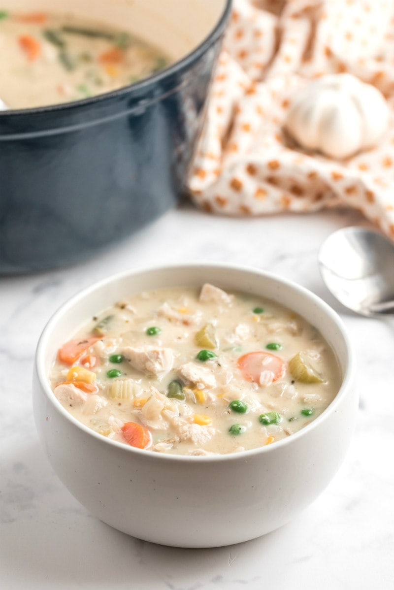 creamy chicken and rice soup in a white bowl