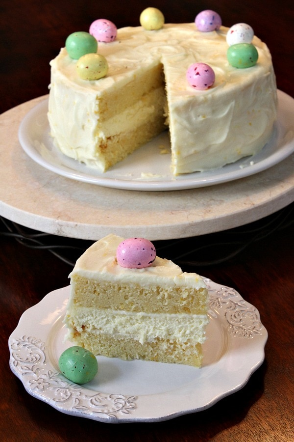Lemon Cheesecake Cake on plate and slice on plate, garnished with chocolate Easter eggs
