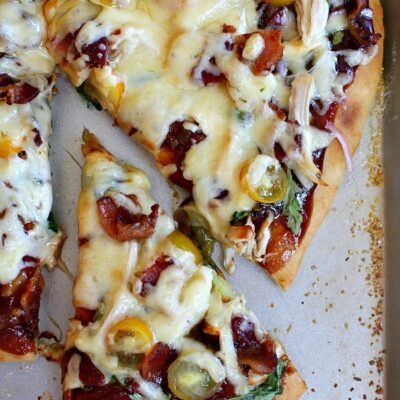 bbq chicken pizza with slice cut out