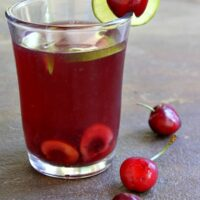 glass of cherry limeade sangria