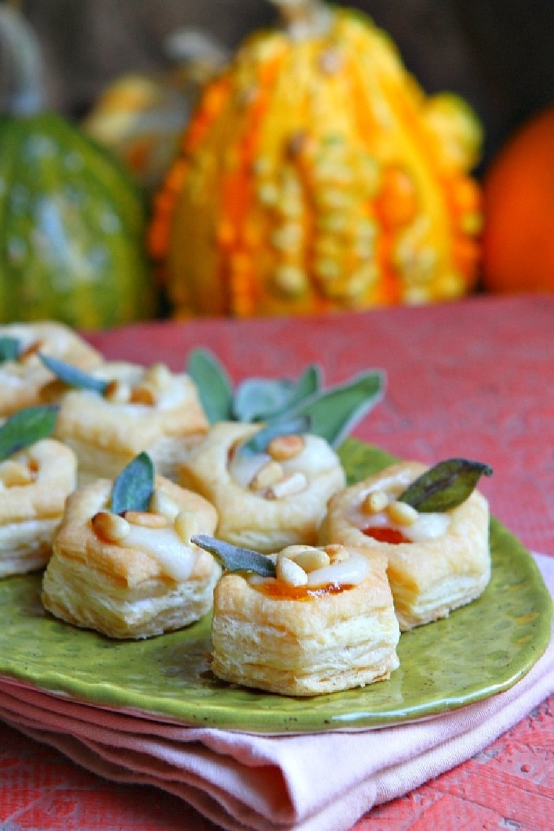 apricot brie bites appetizers on a green platter