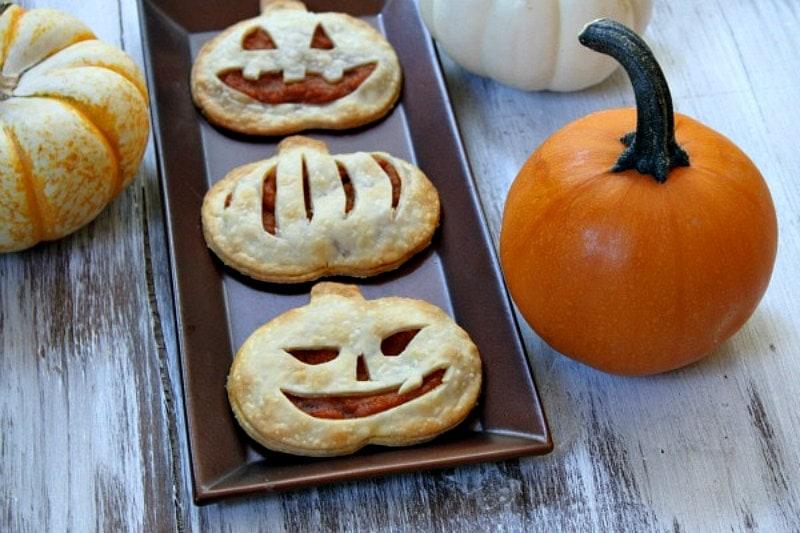 pumpkin pie pop tarts on a tray with pumpkin in background