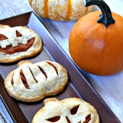 pumpkin pie pop tarts on a tray with pumpkins in background