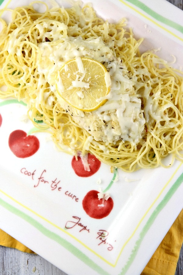 Lemon Chicken Parmesan over pasta on a plate