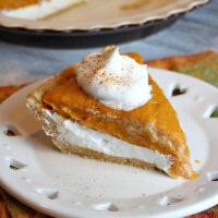 slice of pumpkin pie on a white plate