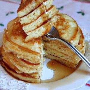 pinterest image for eggnog pancakes