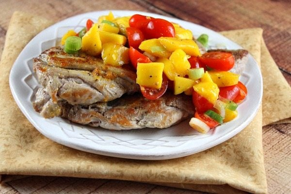 Orange Ginger Pork Cutlets with Mango Tomato Salsa recipe from RecipeGirl.com