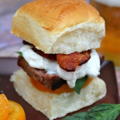 filet mignon caprese slider skewered with a sandwich pick. Beer on the side.