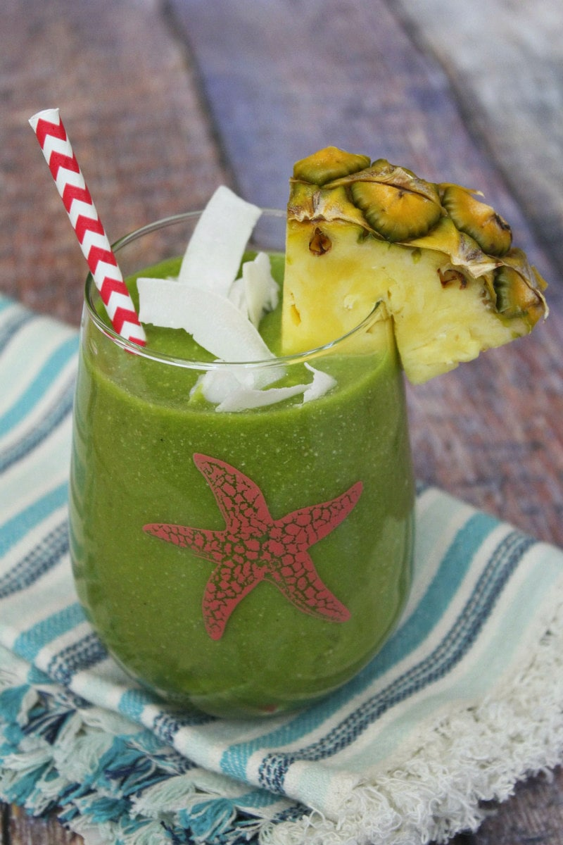 Tropical Green Smoothie with Coconut and Pineapple Garnish