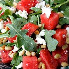 close up of watermelon, feta and arugula salad