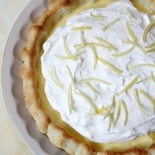 lemon sour cream pie garnished with lemon rind