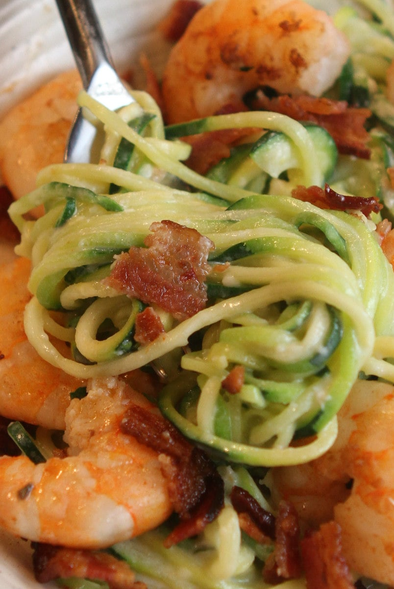 fork of alfredo zoodles with bacon and shrimp
