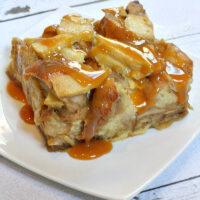 slice of caramel apple bagel bread pudding on white plate