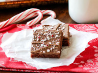 Easy, moist, chocolaty Peppermint Texas Sheet Cake smothered in peppermint infused chocolate frosting is the perfect, easy holiday dessert for you neighbors, friends and family!