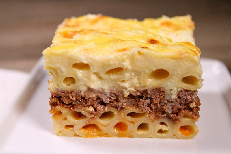 slice of pastitsio sitting on a white plate
