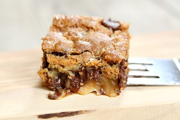 Gooey Salted Caramel Chocolate Chip Cookie Bar on spatula