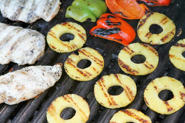 Grilling chicken and pineapple and bell peppers