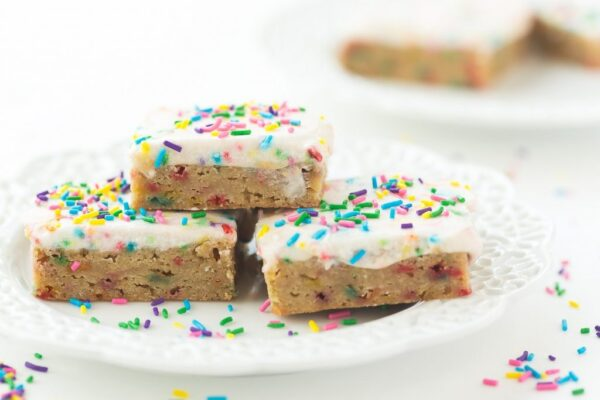 These Funfetti Frosted Blondies are dense, chewy and full of sprinkles! They're perfect for kids lunch boxes or a simple celebration!