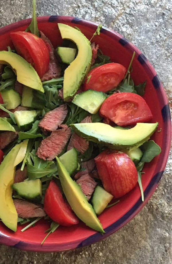 A simple salad filled with good stuff: organic greens, heirloom tomatoes, avocado, cucumber, and grass-fed steak. TesseMae's Balsamic dressing drizzled on top.
