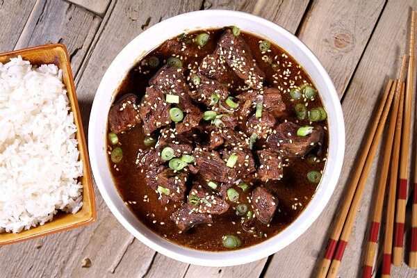 Easy Slow Cooker Korean Beef recipe served over hot steamed rice - great family dinner recipe from RecipeGirl.com