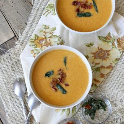 two bowls of sweet potato soup