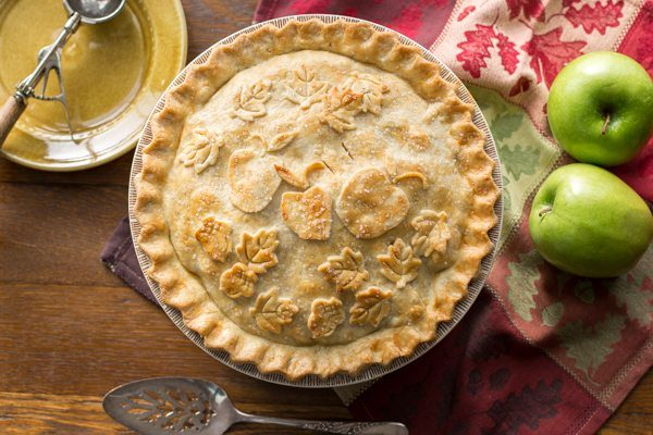 Classic Double Crust Apple Pie - tart, juicy apples are wrapped in a flaky, buttery pastry then baked until golden brown. Great served with ice cream!