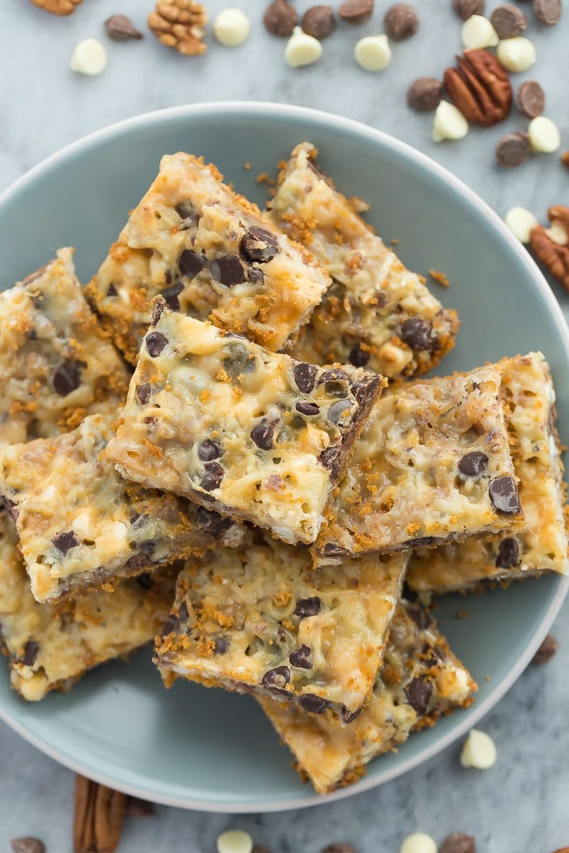 These Seven Layer Bars have a graham cracker crust and are piled with nuts, coconut, chocolate chips and white chocolate chips.  Recipe from RecipeGirl.com.
