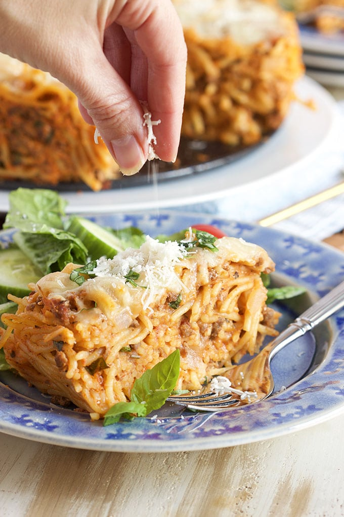 Slice of Easy Spaghetti Pie sprinkled with cheese