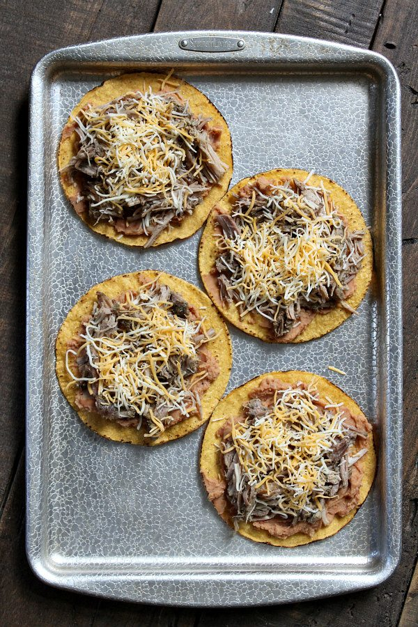 Carnitas Tostadas with Pineapple Guacamole - recipe from RecipeGirl.com