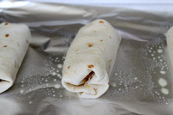 Roasted Chicken Southwestern Baked Burritos - recipe by RecipeGirl.com