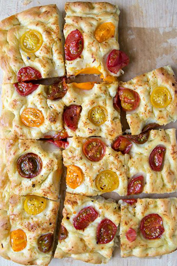 Tomato Focaccia Bread cut into slices with one slice missing