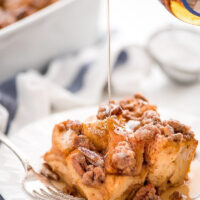 slice of pumpkin french toast casserole with syrup