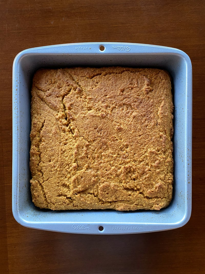 pumpkin cornbread in a baking pan just out of the oven