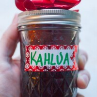 homemade kahlua in a jar with a red bow