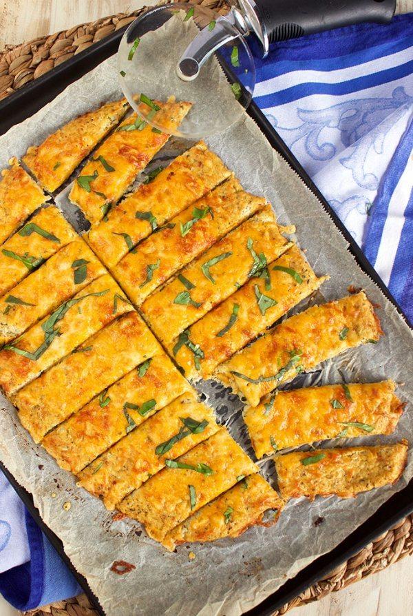 Easy Cheesy Cauliflower Breadsticks recipe by RecipeGirl.com