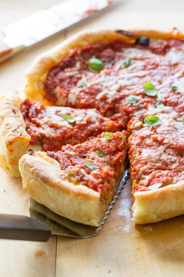 chicago deep dish pizza pulling out slices with a spatula