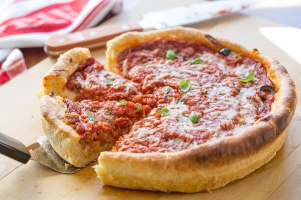 chicago style deep dish pizza pulling out slices with a spatula