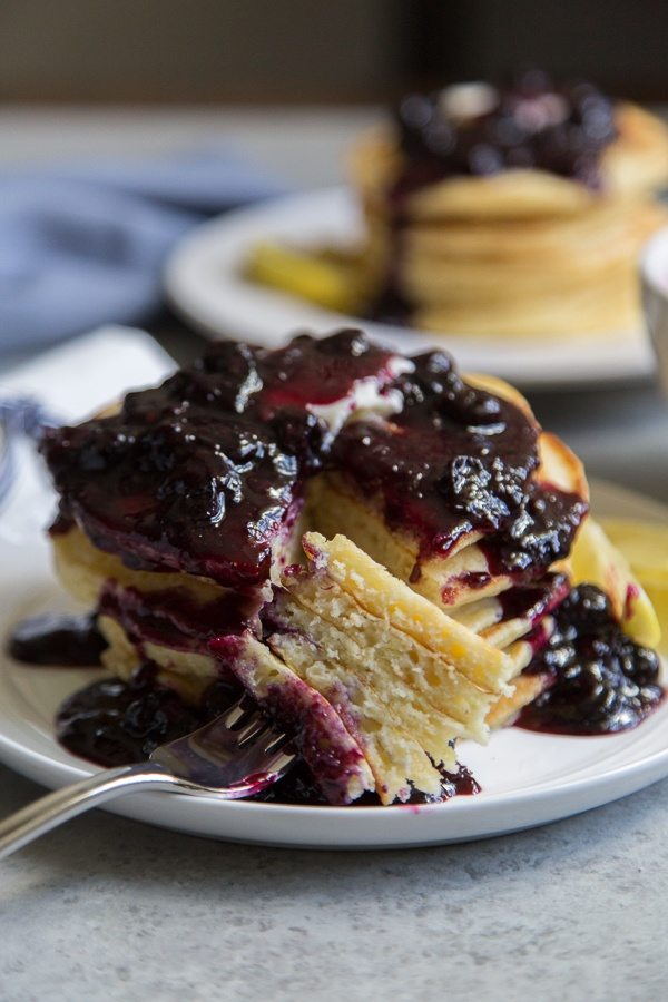 Forkful of Lemon Pancakes with Blueberry Sauce