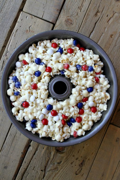 Patriotic Marshmallow Popcorn Cake in a bundt pan