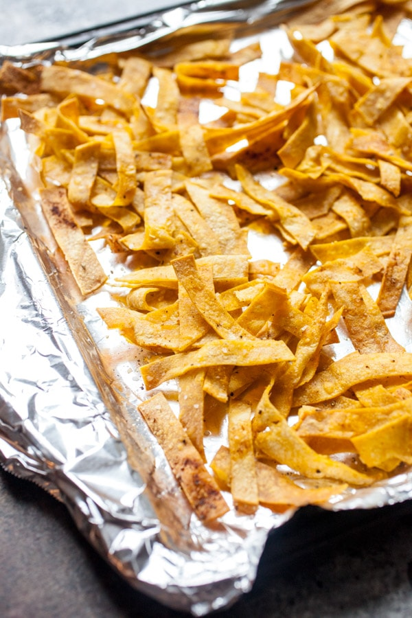 Crispy Tortilla Strips on a foil lined baking sheet