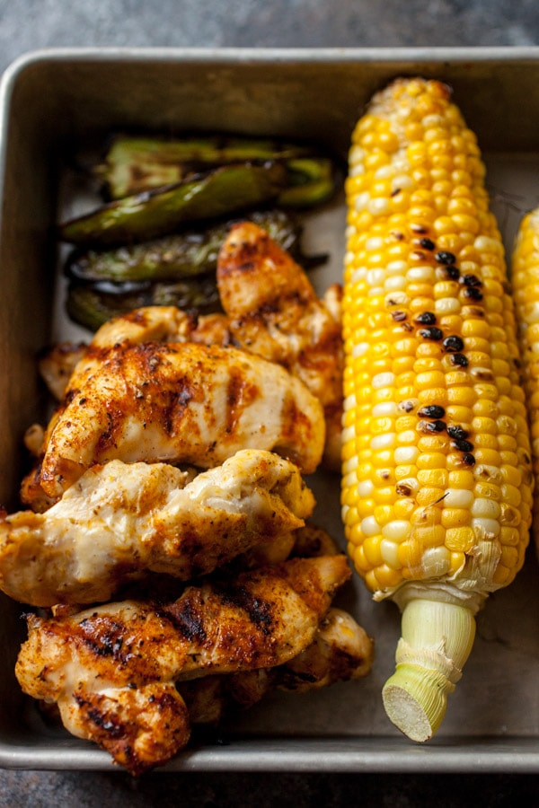 Grilled Chicken and Vegetables- corn and jalapeno set on a baking sheet