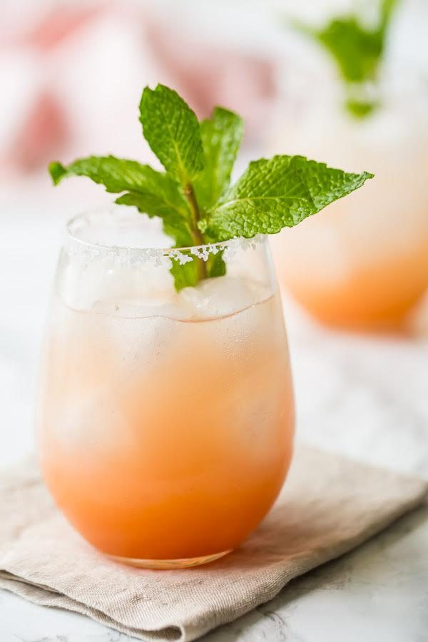 Paloma Cocktail garnished with mint