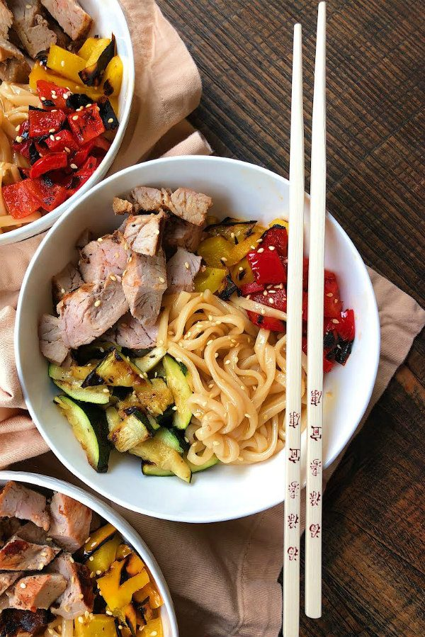Grilled Pork and Vegetable Teriyaki Noodle Bowls in white bowls with chopsticks