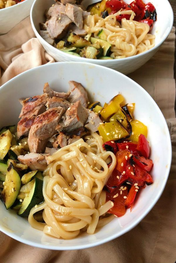 Two Grilled Pork and Vegetable Teriyaki Noodle Bowls in white bowls