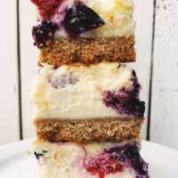 stack of 3 red, white and blueberry cheesecake bars