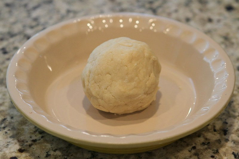 Ball of Cream Cheese Pie Crust ready to be pressed into the pie plate