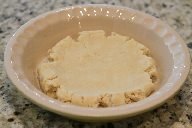 Cream Cheese Pie Crust sitting in a pie plate waiting to be pressed into the plate